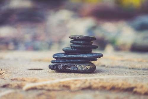 road black stone arrangement in closeup photography gravel