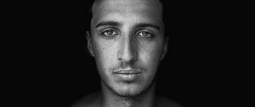 face grayscale photo of mans face portrait