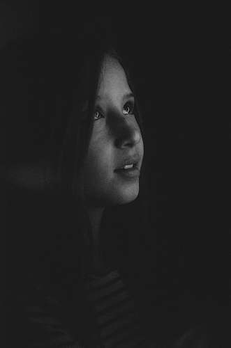 portrait grayscale photography of a girl looking up person