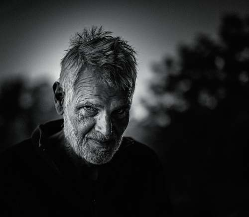 face grayscale photography of man portrait