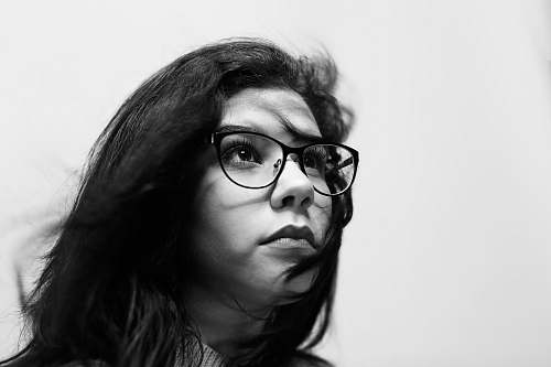person grayscale photography of woman wearing eyeglasses people
