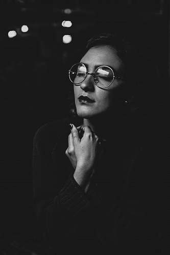 person grayscale photo of woman wearing eyeglasses black-and-white