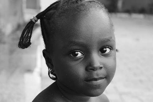 person grayscale photography of child black-and-white