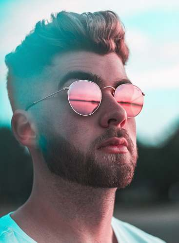 portrait close-up photography of man wearing red lens sunglasses human