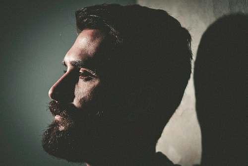 human closeup photo of man with beard person
