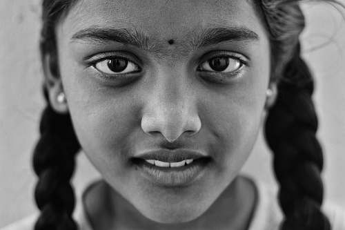person grayscale photo of a girl taking a photo black-and-white