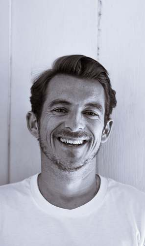portrait grayscale photography of man smiling human