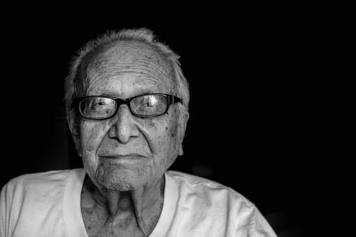 portrait grayscale photography of man wearing shirt and eyeglasses black-and-white