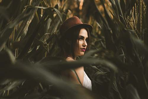woman woman in white shirt with hat standing on corn field female
