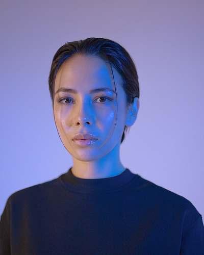 portrait woman wearing black crew-neck shirt person