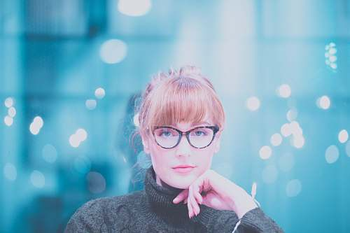 person woman wearing gray turtle-neck sweater posing at camera glasses