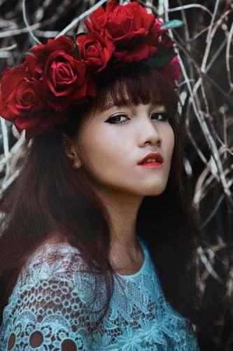 portrait woman wearing red flower crown human