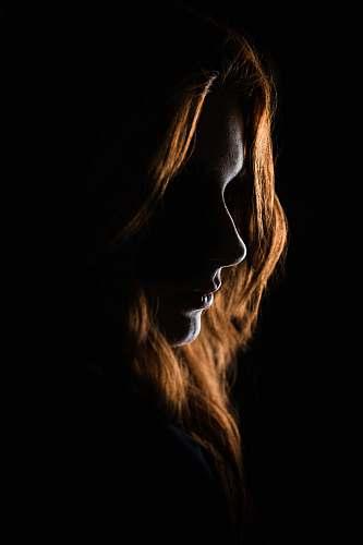 portrait woman's face on black background ornament