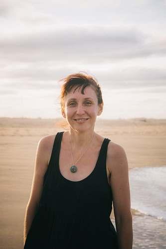 person women's black tank top beach