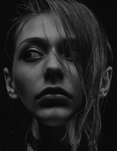 human grayscale photography of woman wearing choker necklace black-and-white