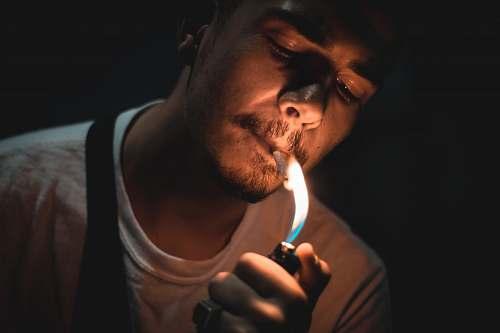 human man lighting cigarette people