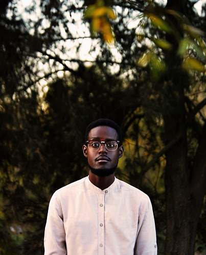 human man wearing white button-up shirt people