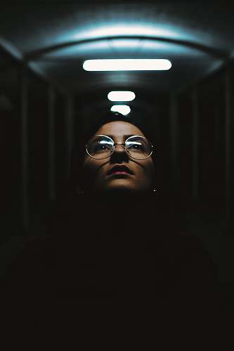 portrait shallow focus photography of woman in clear eyeglases with silver frames face