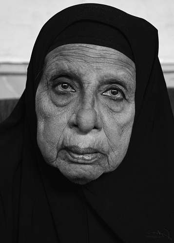 human woman in black hijab black-and-white