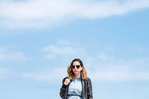 human woman wearing black zip-up jacket people