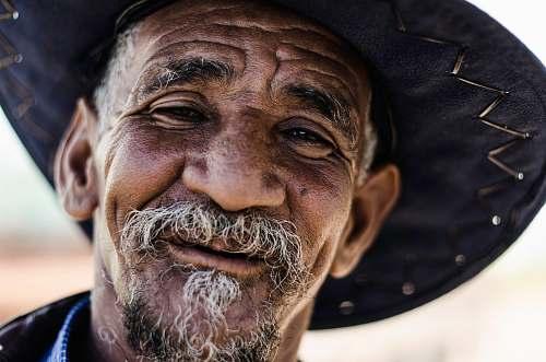 face closeup photography of man wearing black hat old man