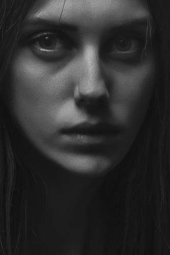 person grayscale woman face black-and-white