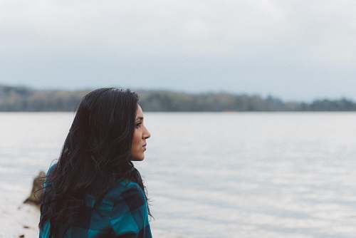 female woman on sea shore lake
