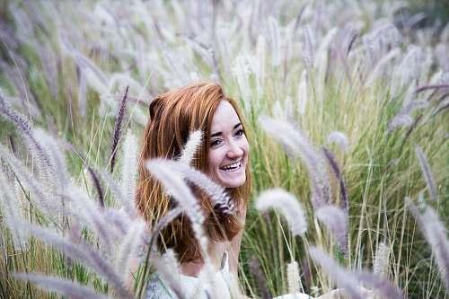 portrait woman sitting on grass field female