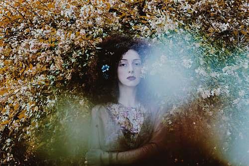 portrait woman standing under floral palnt female