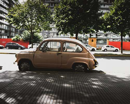 photo buenos aires brown 3-door hatchback parked near road gutter car free for commercial use images