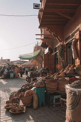 shop people in market selling goods during daytime human
