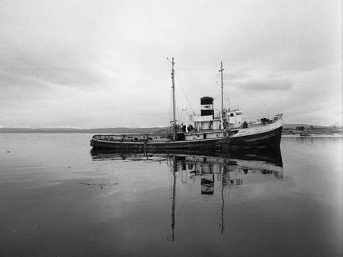 steamer grayscale photo of fishing vessel on body of water ushuaia
