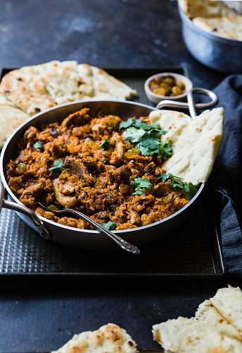 food cooked meat on pan curry