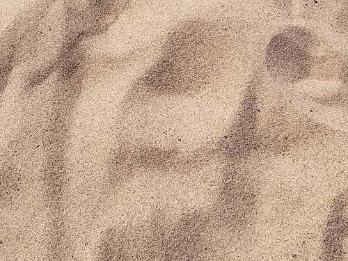 photo sand focus photo of brown sand soil free for commercial use images