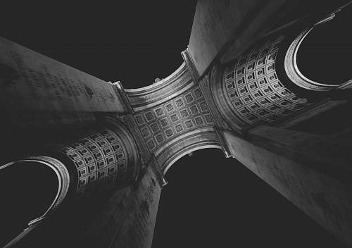 black-and-white low angle photography of building architecture