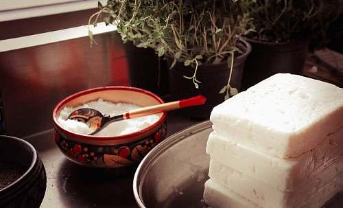 cream red ceramic bowl on gray spoon creme
