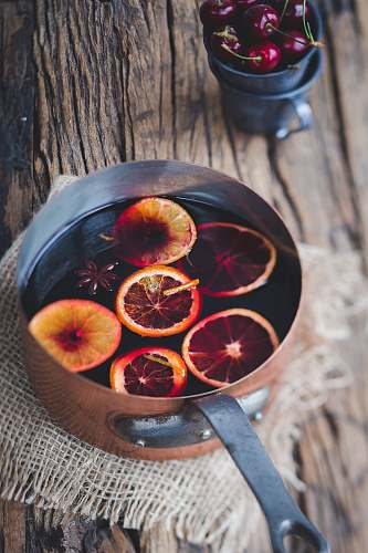 winter close-up photography of sliced orange fruit on brown cooking pot london