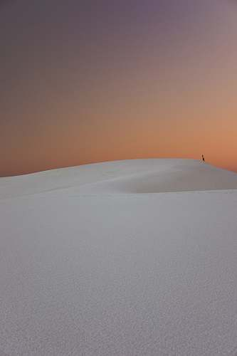 iphone wallpapers person walking in the desert dunes iphone backgrounds