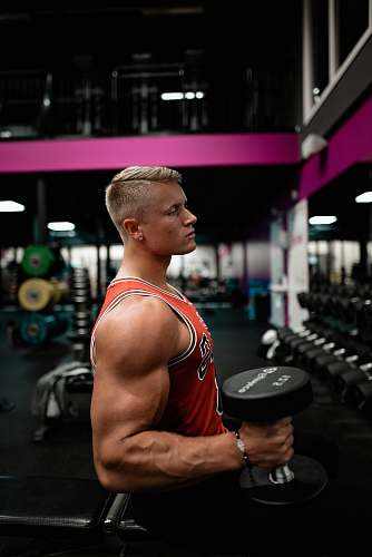 photo fitness man standing while holding dumbbell inside gym sport free for commercial use images
