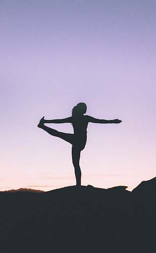photo fitness silhouette of woman doing yoga yoga free for commercial use images