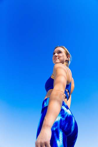 photo person low angle photography of woman in blue brassiere and blue bottoms clothing free for commercial use images