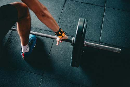 photo person man holding black barbell human free for commercial use images