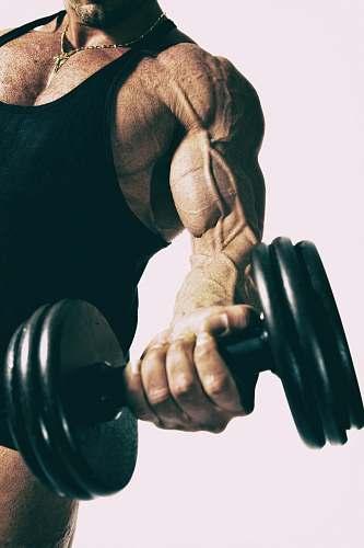 sport man lifting black dumbbell exercise