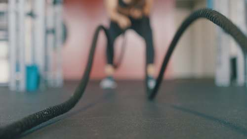 photo gym person holding black exercise rope scottsdale free for commercial use images