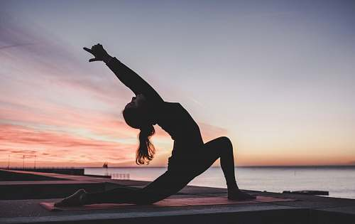 photo sport silhouette photography of woman doing yoga yoga free for commercial use images