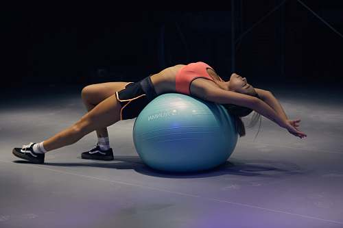 sport woman doing yoga on stability ball exercise