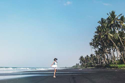 photo exercise woman standing on beach during daytime jogging free for commercial use images
