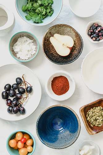 produce An overhead shot of fruits, seeds and spices in bowls health
