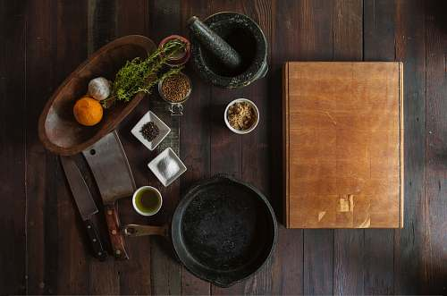 photo spices black mortar and pestle beside brown box in top view photography herbs free for commercial use images