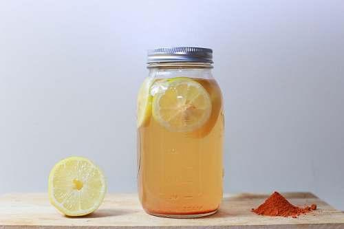 drink clear glass mason jar on brown surface jar
